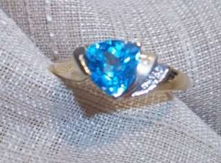 14k yellow gold blue topaz trillion diamond accent ring