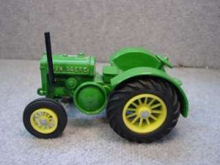 We are offering to you a Two Ertl John Deere Tractors 116 scale