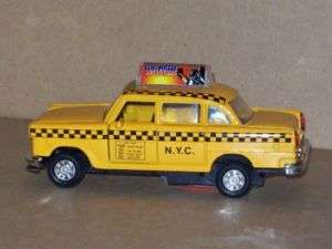 NYC Checkered Taxi Cab Diecast Metal Car Rolling Action