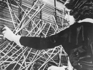 Female Telephone Switchboard Operator Connecting Caller Photographic