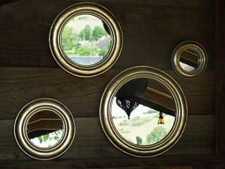 set of four round gold leaf mirrors by begolden