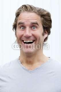 Photo visage dhomme jeune ahuri souriant © laurent hamels #24907581