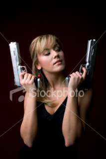 Girl with guns Royalty Free Stock Photo